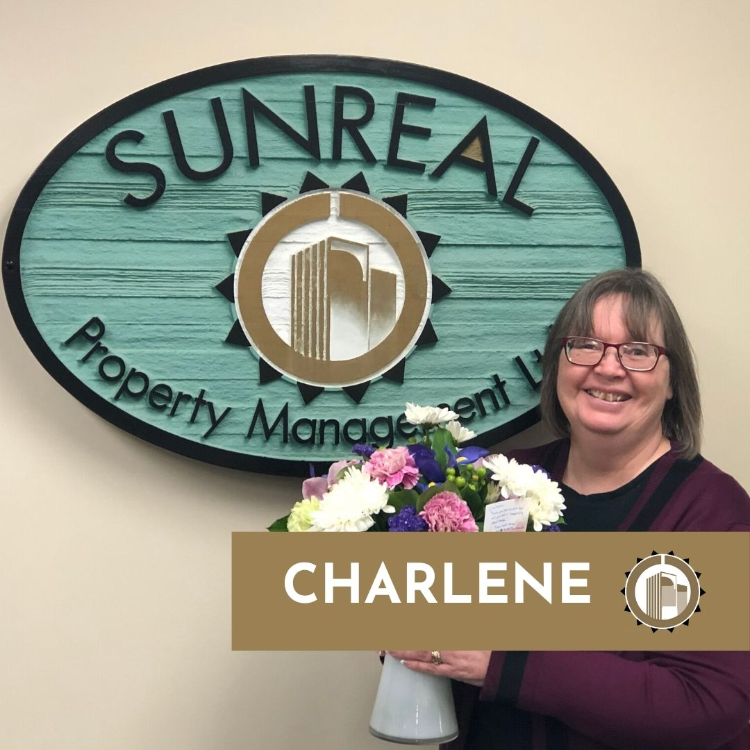 woman holding flowers receptionist sunreal property management ltd